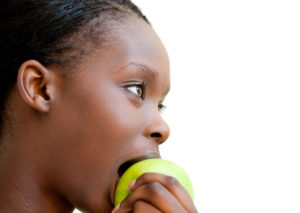 photodune-8235245-cute-woman-eating-apple-xs (tinified)